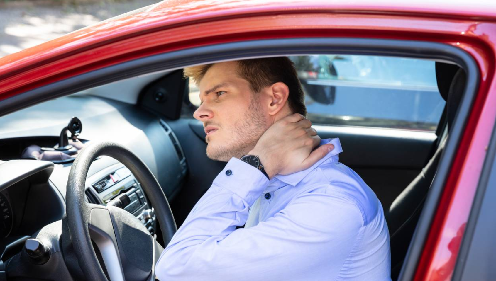 A man suffering from neck pain after a car accident