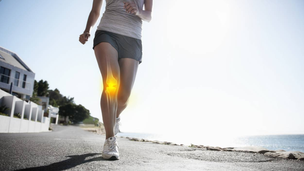 A lady running with knee cartilage damage symptoms