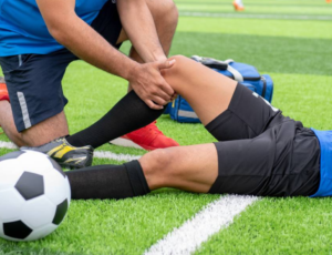A man holding a medial meniscus injury