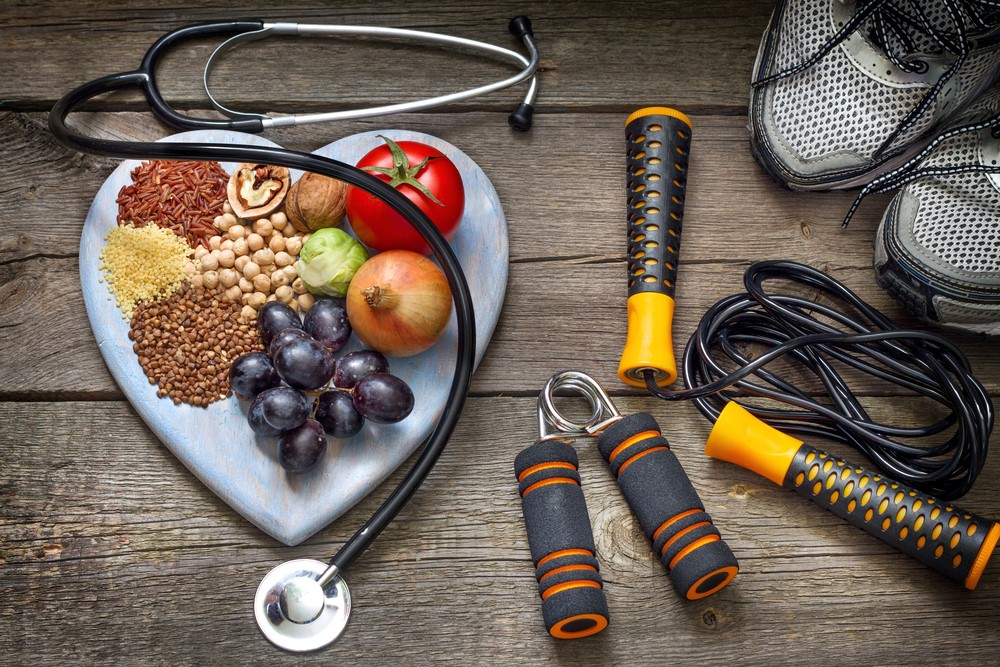 A picture of healthy food and a skipping rope