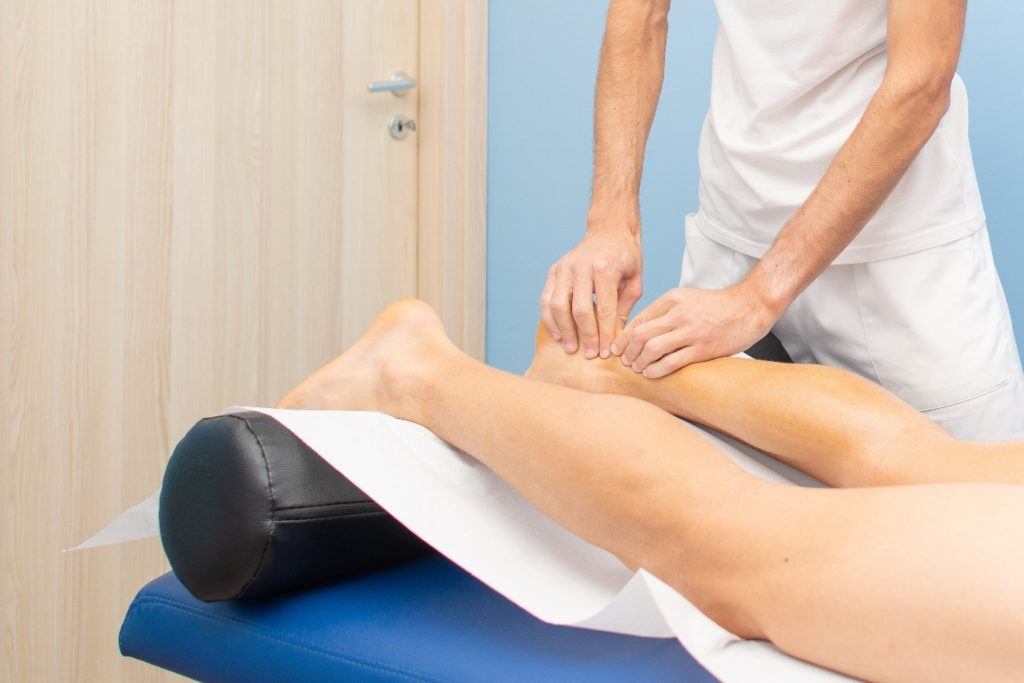A physiotherapist treating Achilles tendinopathy