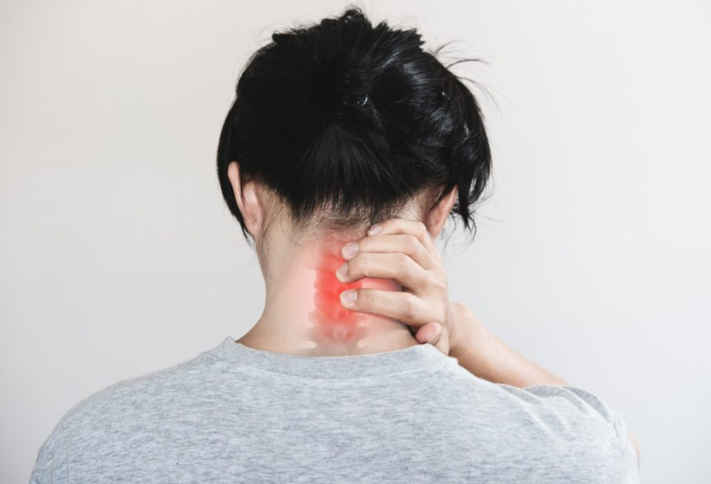 A lady with cervical instability holding her neck